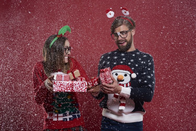 Christmas nerd couple with presents